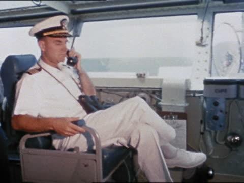 intrepid captain giving orders for recovery of mercury 7 capsule / looking through binoculars - binoculars stock videos & royalty-free footage