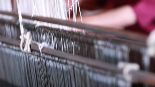 intricacies of a myanmar fabric loom - strength stock videos & royalty-free footage