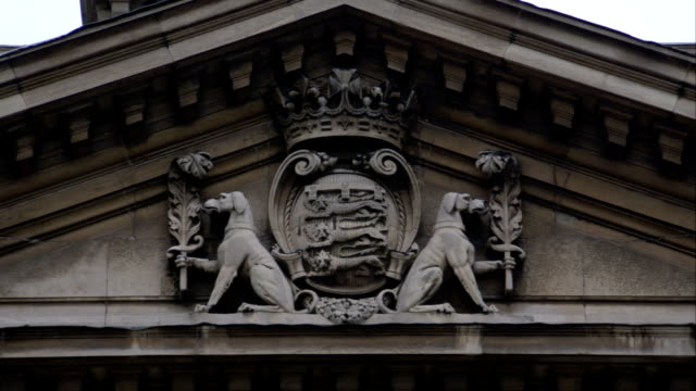 intricate carvings adorn the county sessions house in liverpool, england. available in hd. - frontgiebel stock-videos und b-roll-filmmaterial