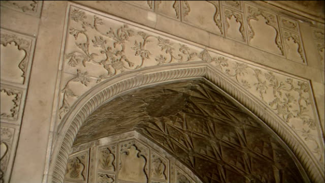 Intricate carvings cover the arches of Khas Mahal at Agra Fort in India.