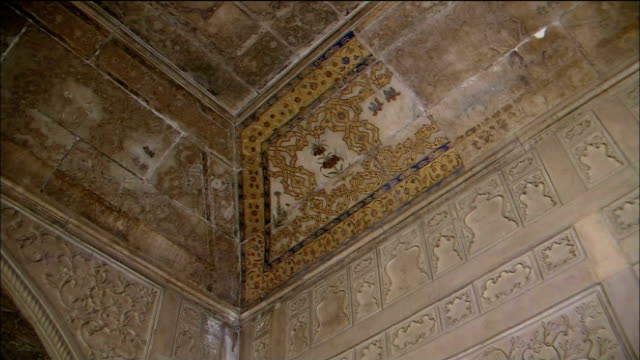 Intricate carvings cover the ceilings of Khas Mahal at Agra Fort in India.