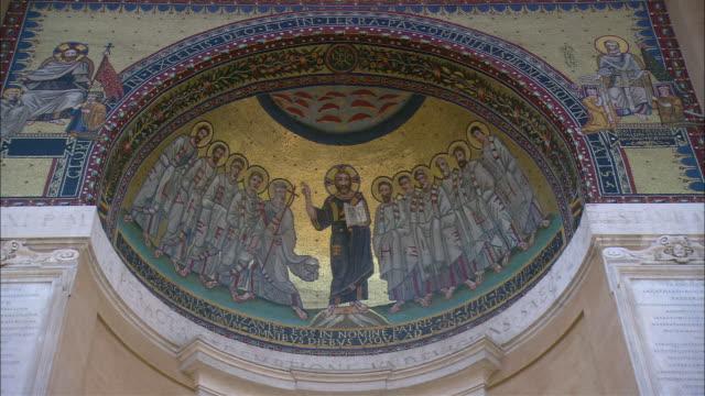 Intricate designs border a fresco inside St Peter's Basilica.