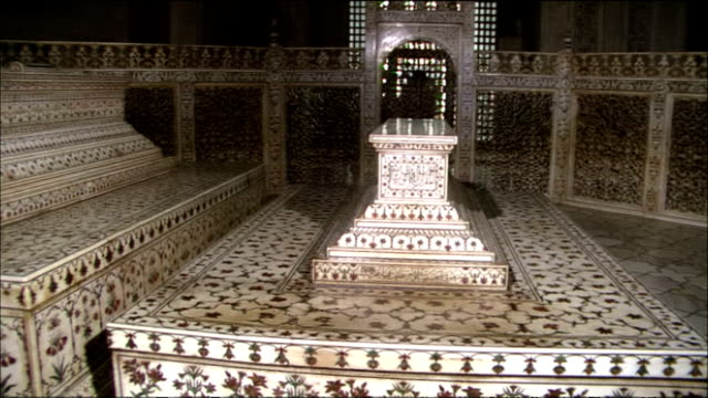 intricate engravings cover the tombs of shah jahan and mumtaz mahal in the taj mahal. - mausoleum stock videos and b-roll footage