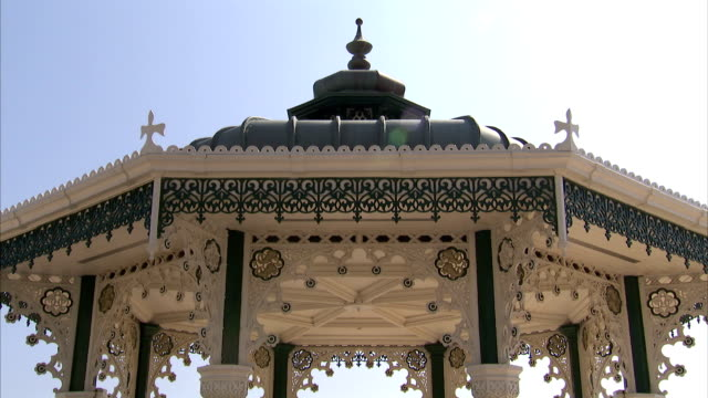 intricate metal filigree decorates a gazebo. available in hd. - gazebo stock videos and b-roll footage