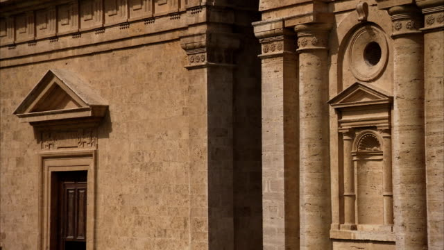 intricate moldings cover the facade of the san biagio church in montepulciano, italy. available in hd. - frontgiebel stock-videos und b-roll-filmmaterial