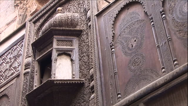 intricate scroll work decorates an arched window and facade. - erkerfenster stock-videos und b-roll-filmmaterial