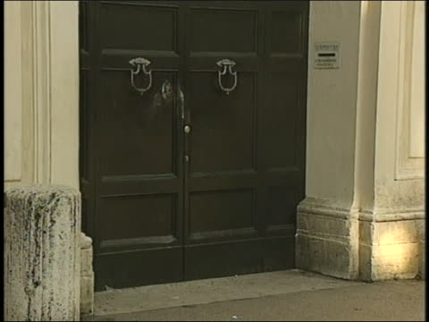 intricate stone carvings reveal architectural details above a doorway in rome - ペディメント点の映像素材/bロール