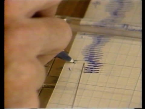 introduction of polygraph vetting tx washington ms girl being tested cs machine marking graph paper cs same ms man asking questions cs machine... - graph paper stock videos and b-roll footage