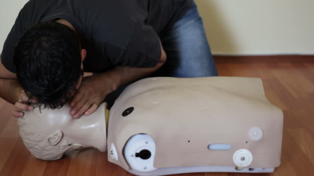 intubation of a cpr doll - respiratory machine stock videos & royalty-free footage