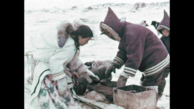 Inuit family prepares to move