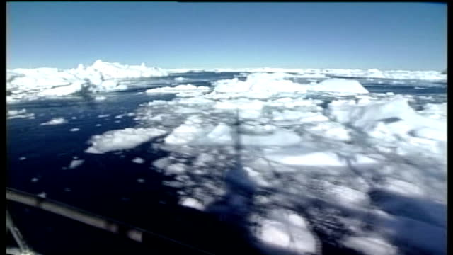 inuit leader campaigns against stansted airport expansion; greenland: white icebergs in blue sea shot of bow of ship along through ice floes - ice floe stock videos & royalty-free footage
