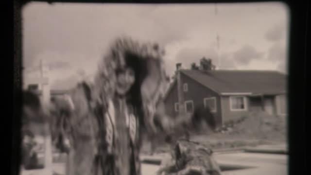 vidéos et rushes de inuit yupik aleut eskimos native americans jump on trampolines in alaska in traditional dress - vêtement traditionnel