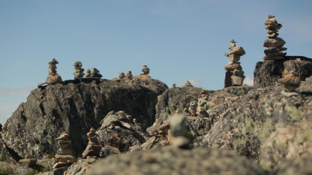 inukshuks balanced on the top of the mountain - stack stock videos & royalty-free footage