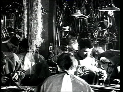 1915 montage b/w invalids from wwi working as cobblers and sewing clothes and other goods in factory/ russia - sewing machine stock videos & royalty-free footage