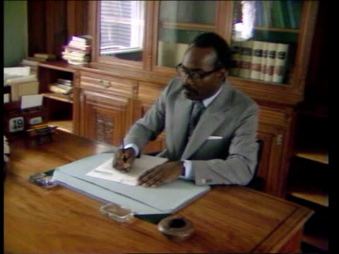 26483 grenada st george sir paul scoon governor of grenada writing at desk - st. george's grenada stock videos and b-roll footage