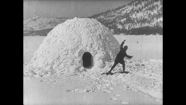 1922 inventive man (buster keaton) uses guitars as snow shoes - igloo stock videos & royalty-free footage