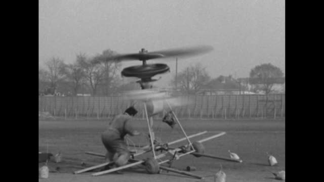 inventor douheret starts up rotors of his helicoplane steps aside and runs out of the way as the contraption falls over / men run to helicoplane lift... - 1910 1919 stock videos and b-roll footage
