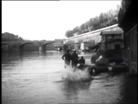 1930 montage inventor jumping into river wearing special water suit / rome, italy - scoperta video stock e b–roll