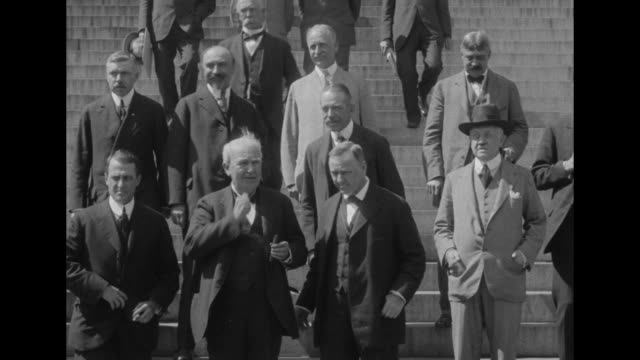 Inventor Thomas Edison and US Secretary of the Navy Josephus Daniels lead group of scientists and government officials down EXT steps of the US...