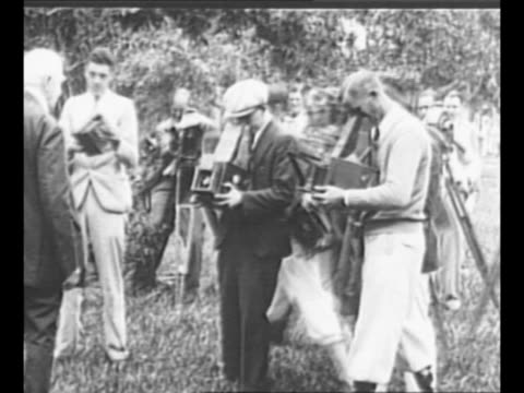 inventor thomas edison poses for photographs in florida as journalists take pictures with box cameras and newsreel cameras / edison looks solemn /... - photographic equipment stock videos & royalty-free footage