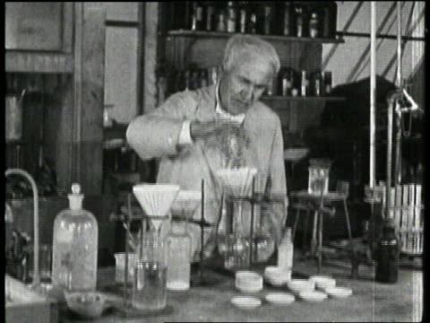 inventor thomas edison pours liquids into beakers - bunsen burner stock videos & royalty-free footage