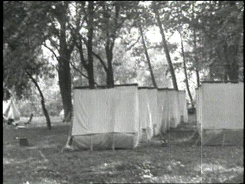 Inventors Thomas Edison Henry Ford tire manufacturer Harvey Firestone and U S President Warren G Harding enjoy a camping trip