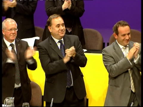 inverness nicola sturgeon at podium at snp annual conference alex salmond mp applauding sturgeon along and being kissed on cheek by salmond clean... - scottish national party stock videos & royalty-free footage