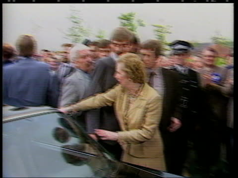 inverness ms then prime minister margaret thatcher leaning over car to shout greater manchester stockport brewery tms crowd of angry demonstrators... - stockport bildbanksvideor och videomaterial från bakom kulisserna
