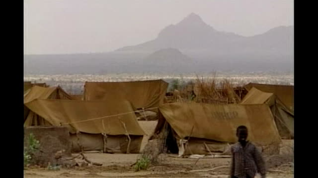 investigation blames human activity for global warming:; file / tx 31.5.06 chad: camp gaga: ext long shot of unhcr tents at refugee camp back view of... - human back stock videos & royalty-free footage