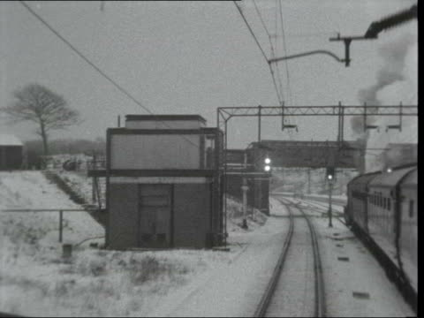 investigation into aws signalling; **also available as fs040163002** england: merseyside: liverpool: liverpool lime street station: ext / snow i/c... - signal box stock videos & royalty-free footage