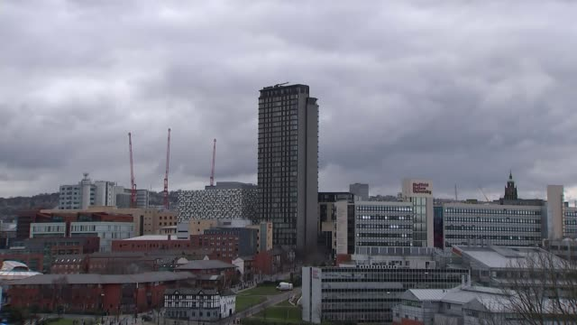 investigation uncovers alleged homophobia and untrained staff at governmentfunded charity sheffield ext city skyline woman entering building wide... - ホモフォビア点の映像素材/bロール