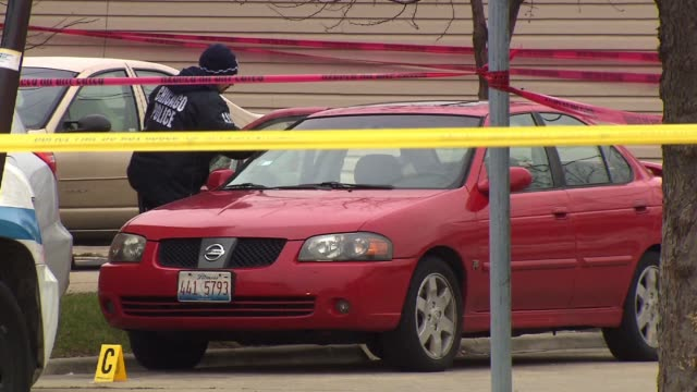wgn investigator at crime scene dusting a car for fingerprints on december 10 2012 in chicago illinois - csi: crime scene investigation television show stock videos & royalty-free footage