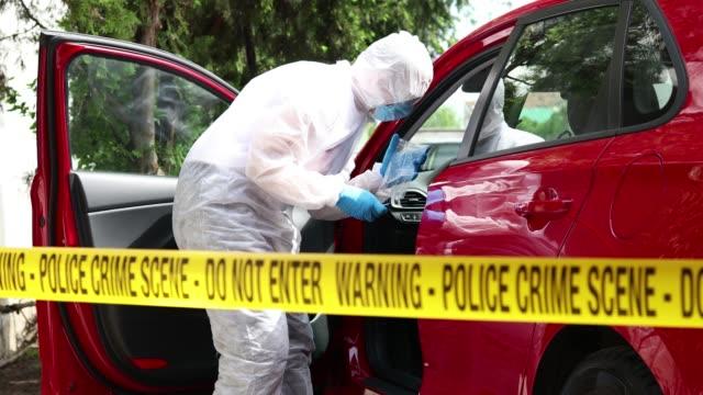 investigator holding drug bag on a crime scene - narcotic stock videos & royalty-free footage
