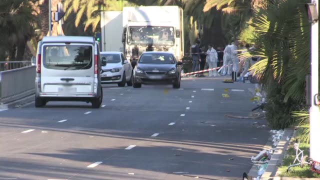 Investigators arrived on the scene after a gunman smashed a truck into a crowd of revellers celebrating Bastille Day in the French resort of Nice...