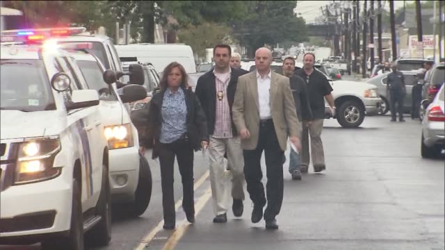 investigators in elizabeth, n.j., near the last known residence of ahmad khan rahami, who was arrested on monday in the weekend bombing in manhattan. - manhattan video stock e b–roll
