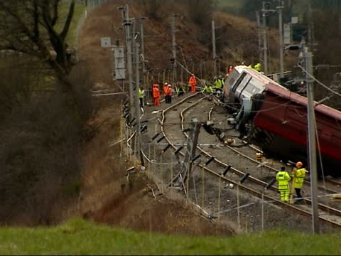 investigators inspect train and track following virgin train crash in cumbria england cumbria grayrigg ext long shots of investigators around... - train crash stock videos and b-roll footage
