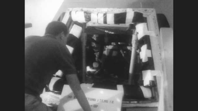 nasa investigators peer into the burnout remains of the apollo capsule that caught fire in january of 1967 / three investigators in contamination... - ed white astronaut bildbanksvideor och videomaterial från bakom kulisserna