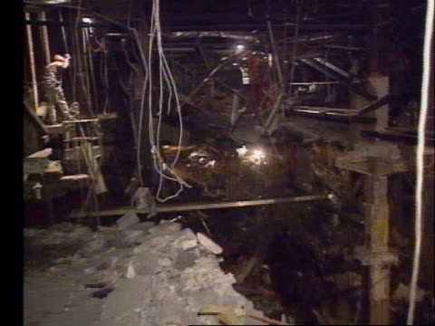 investigators shine flashlights on the shredded remains of the bombed murrah federal building. - oklahoma city bombing stock videos & royalty-free footage