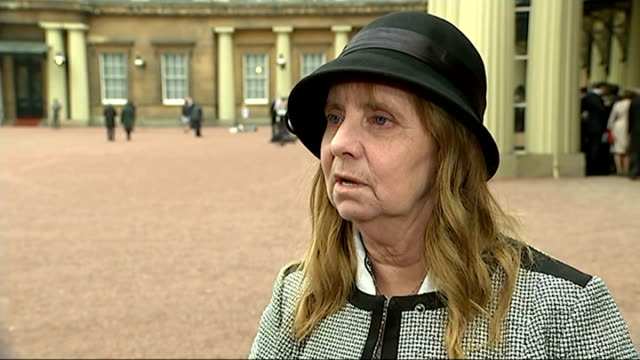 Kristin Scott Thomas Photocall ENGLAND London Buckingham Palace EXT GVs of actress Kristin Scott Thomas with her award / GVs and interviews with...