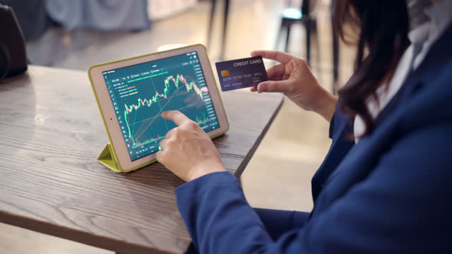 investors use credit card are trading stocks. in the electronic market through computer by the internet via mobile phone. - crash stock videos & royalty-free footage