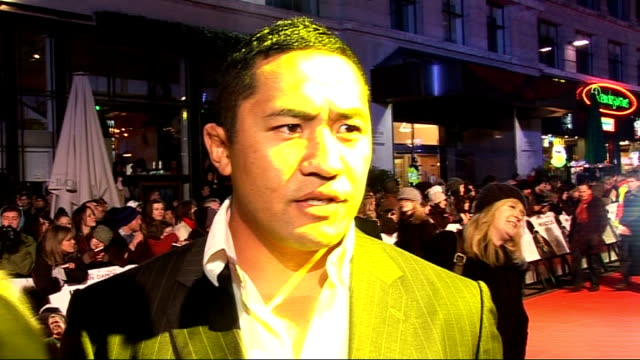 'invictus' uk film premiere cast interviews on red carpet zak feaunati interview sot on the privilege of playing jonah lomu and receiving the casting... - celebrities stock videos & royalty-free footage