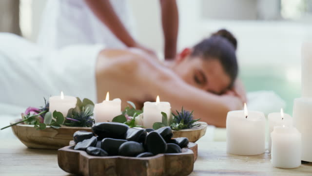 invigorate your body and senses at the spa - massage stock videos & royalty-free footage