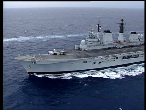 lib at sea air view hms invincible along int sightings being taken on ship's bridge royal fleet arm harrier jump jet taxiing la ms harrier hovering to - aircraft carrier stock videos and b-roll footage