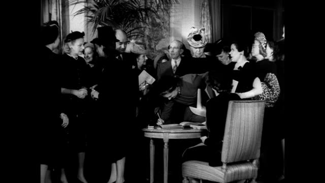 invitation int vs fashion editors signing in designer eleanor lambert receiving guests int vs editors typing looking at publicity pictures public... - 1903 stock videos & royalty-free footage