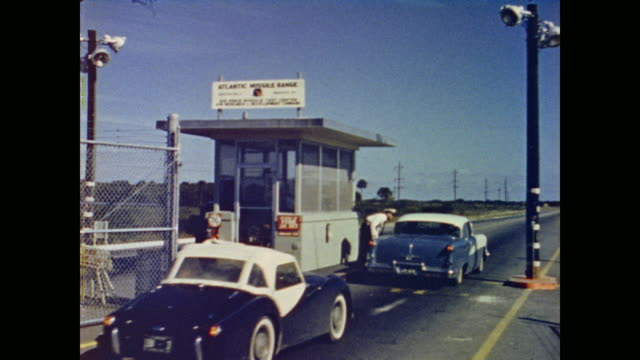 invited civilians drive up to the check point of the atlantic missile range - 1962年点の映像素材/bロール