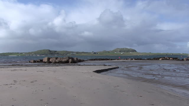 zi iona abbey past body of water / isle of iona, scotland, united kingdom - abbey stock videos & royalty-free footage