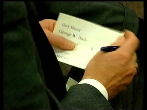 sign pointing way in to caucus meeting man holding slip of paper on which to vote for choice to be republican candidate bowl handed around meeting to... - partito repubblicano degli usa video stock e b–roll