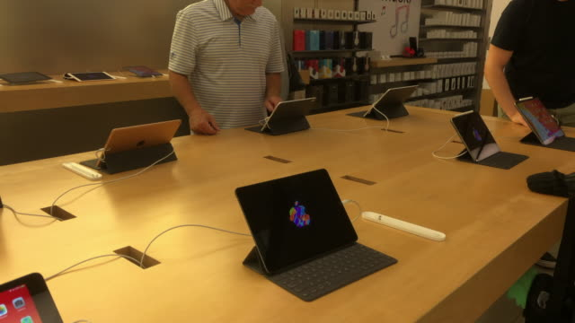 ipad for sale at an apple store inside a houston shopping mall. - digital tablet stock videos & royalty-free footage