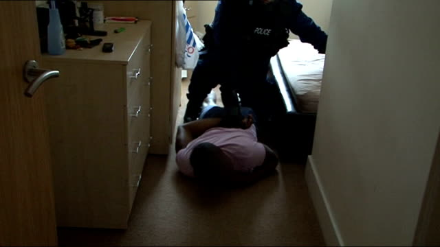 iphone fraudsters arrested by police in earlymorning raids around london england london forest gate city of london police officers outside door of... - face down stock videos & royalty-free footage