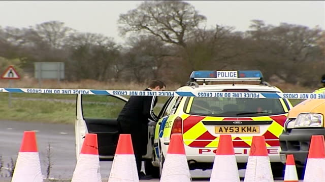 Hunt for murderer of five women / general views of police officers and police vehicles at police cordon ENGLAND Suffolk Levington Police car and a...